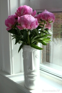 Pink-Peony-bouquet-in-a-white-face-vase