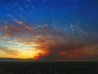 Smoke fills the sky with haze and covers The San Fernando Valley Sunrise